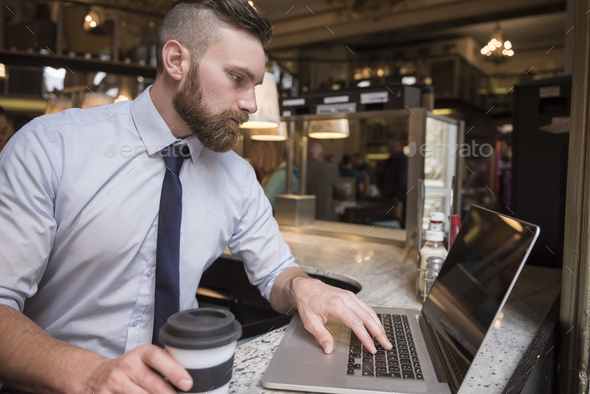 He's hard working on his laptop - Stock Photo - Images