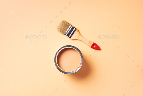 Paint brush and open paint can with on pastel background. Top view, copy space. Appartment - Stock Photo - Images