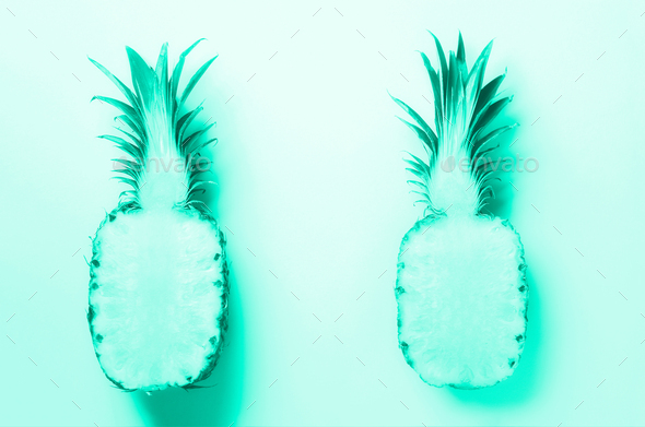 Half of sliced pineapple on mint color background. Top View. Bright pattern for minimal style - Stock Photo - Images