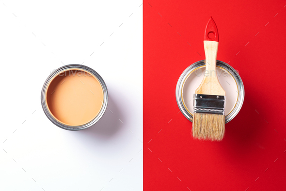 Wooden paint brush, open paint cans on trendy red and white background. Top view, copy space - Stock Photo - Images