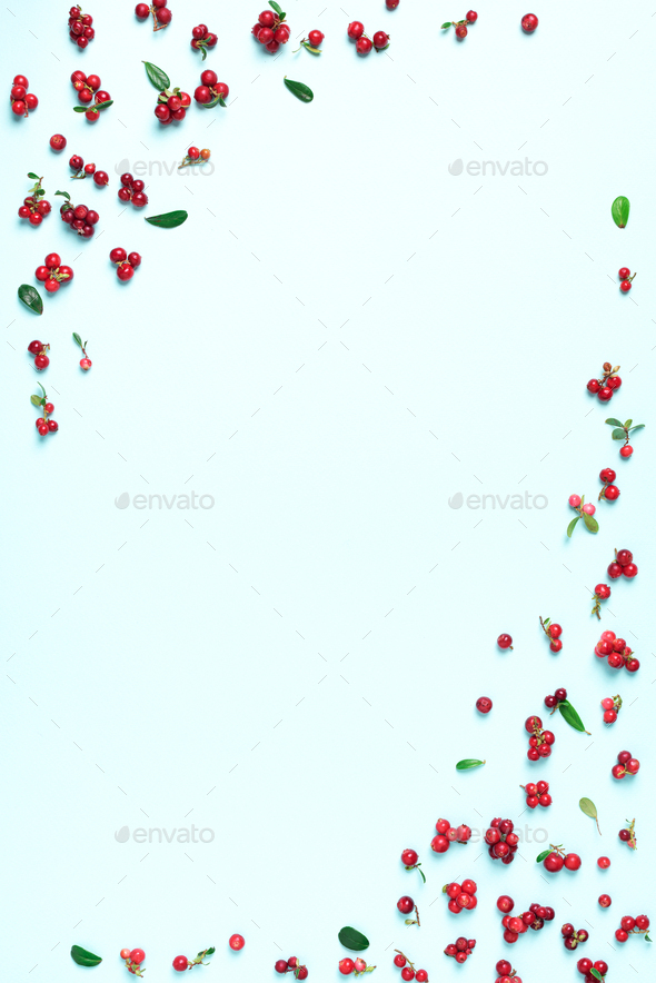 Colourful bright pattern made of natural berries on blue background. Top view. Summer red - Stock Photo - Images