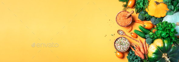 Organic vegetables, lentils, beans, raw ingredients for cooking on trendy yellow background. Healthy - Stock Photo - Images