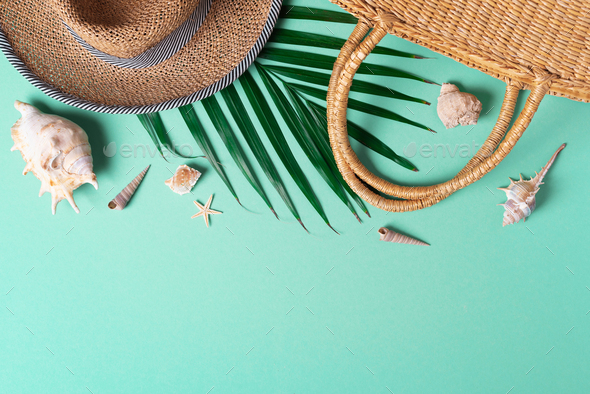 Summer travel concept with women straw bag, hat, palm leaves, shells on trendy green background. Top - Stock Photo - Images