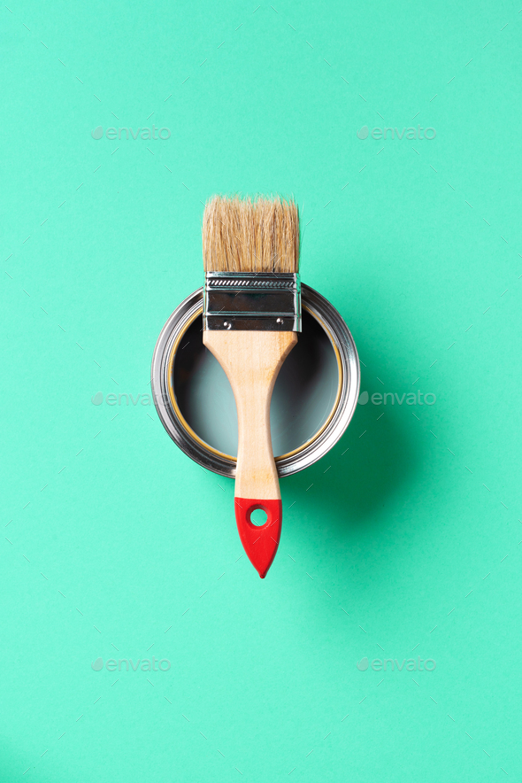 Paint brush and open paint can with on trendy green background. Top view, copy space. Appartment - Stock Photo - Images