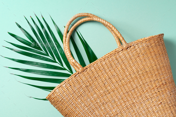 Handmade summer bag on trendy green background. Top view. Fashionable stylish accessory. Natural - Stock Photo - Images