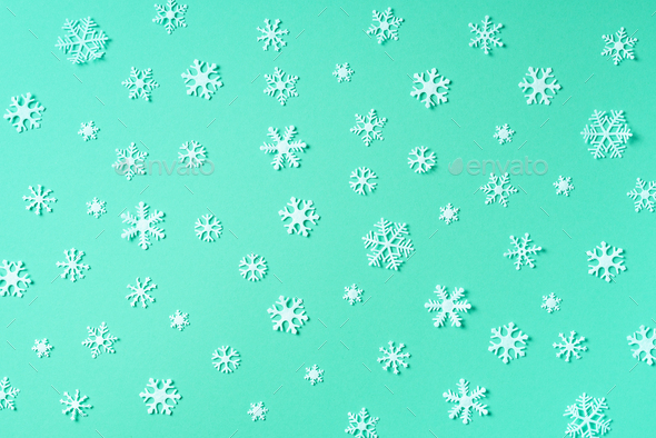 Winter pattern made of white snowflakes on trendy green background. Top view. Flat lay. Winter - Stock Photo - Images