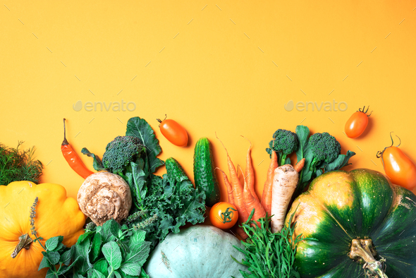 Autumn vegetables on trendy yellow background. Top view. Vegan and vegetarian diet, harvest concept - Stock Photo - Images