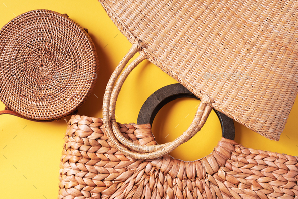 Collection of handmade summer bags on trendy yellow background. Top view. Fashionable stylish - Stock Photo - Images