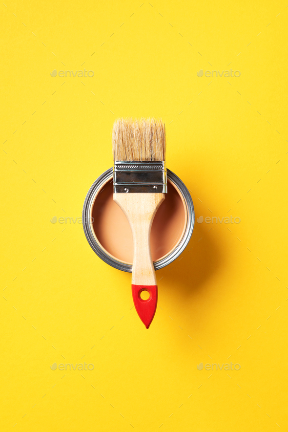 Brush and open paint can with on trendy yellow background. Top view, copy space. Appartment - Stock Photo - Images