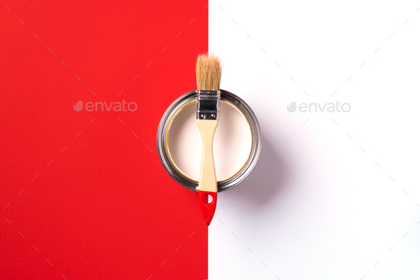 Wooden paint brush, open paint can on trendy red and white background. Top view, copy space - Stock Photo - Images