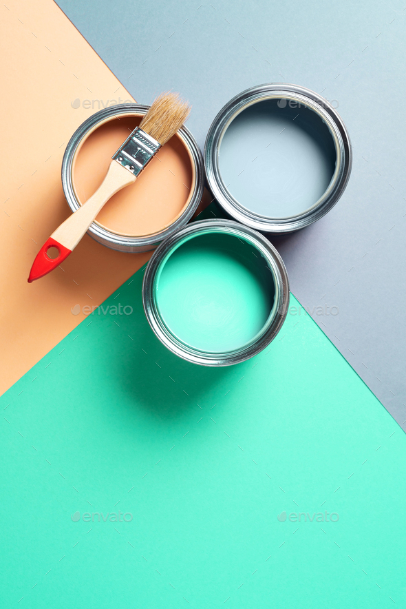 Metal paint cans and paint brushes on multicolor background. Top view. Copy space. Trendy green - Stock Photo - Images