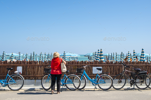 Rental bikes on the beach. Blue bicycles on the street. - Stock Photo - Images