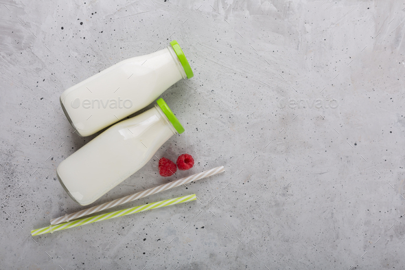 Kefir drink with raspberry on the gray background - Stock Photo - Images