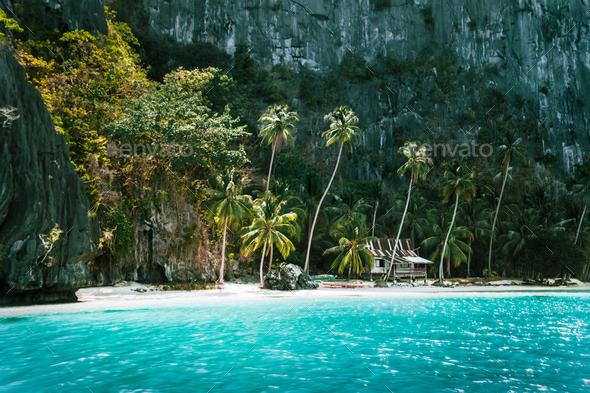 El Nido, Palawan, Philippines. Secluded tropical hut on Pinagbuyutan Island. Amazing white sand - Stock Photo - Images