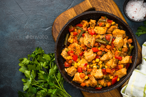 Chicken stir fry with vegetables top view - Stock Photo - Images