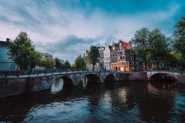Bridge over Keizersgracht Emperor's canal in Amsterdam, dutch scene at twilight, Netherlands - Stock Photo - Images