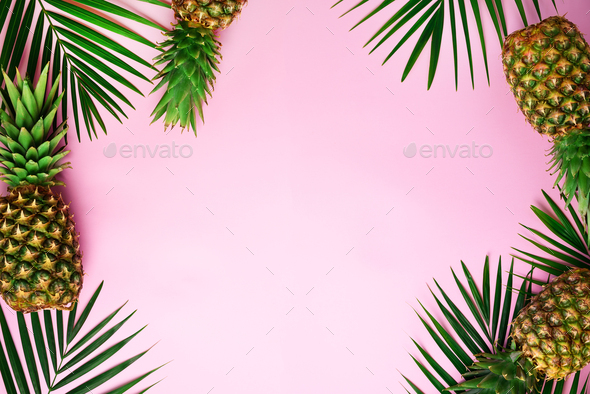 Pineapples and tropical palm leaves on punchy pastel pink background. Summer concept. Creative flat - Stock Photo - Images