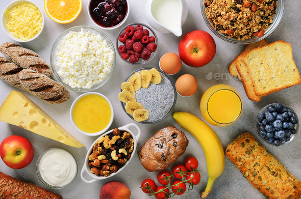 Healthy breakfast ingredients, food frame. Granola, egg, nuts, fruits, berries, toast, milk, yogurt - Stock Photo - Images
