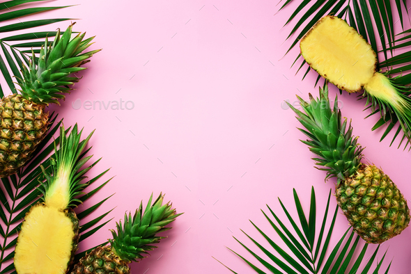 Half slice of fresh pineapple and whole fruit, palm leaves on yellow background. Top View. Copy - Stock Photo - Images