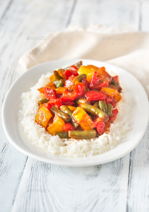 Portion of white rice and fried vegetables - Stock Photo - Images