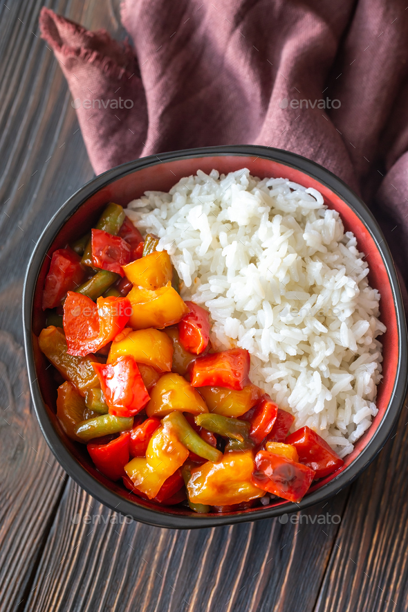 Bowl with white rice and fried vegetables - Stock Photo - Images