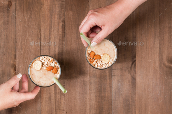 Banana-Oatmeal Smoothy and Females Hands - Stock Photo - Images