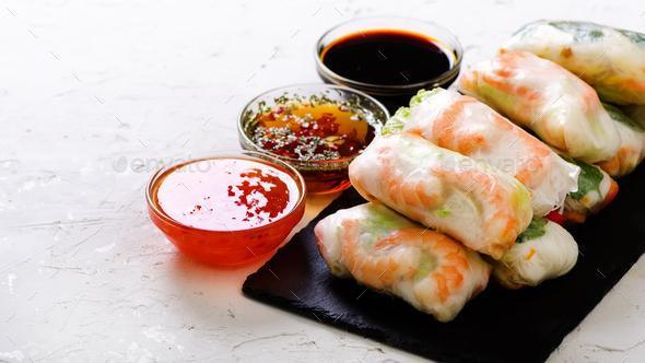 Vietnamese spring rolls - rice paper, lettuce, salad, vermicelli, noodles, shrimps, fish sauce - Stock Photo - Images