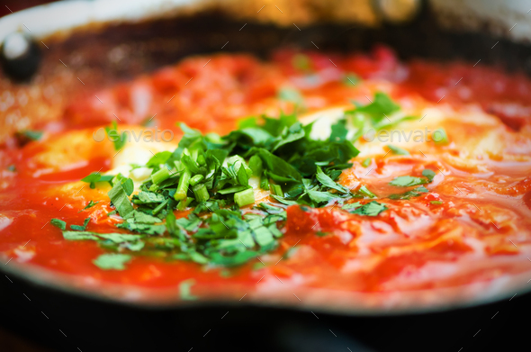 Shakshuka. Traditional jewish food and middle eastern cuisine recipe. Fried eggs, tomatoes, bell - Stock Photo - Images