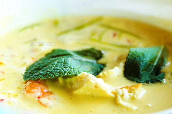 Spicy coconut milk cream soup curry with chiken, tiger prawns, long soy noodles, bean sprouts, lime - Stock Photo - Images