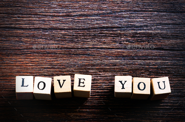 Wood cubes with inscription LOVE YOU on wooden background. Free space for your text - Stock Photo - Images