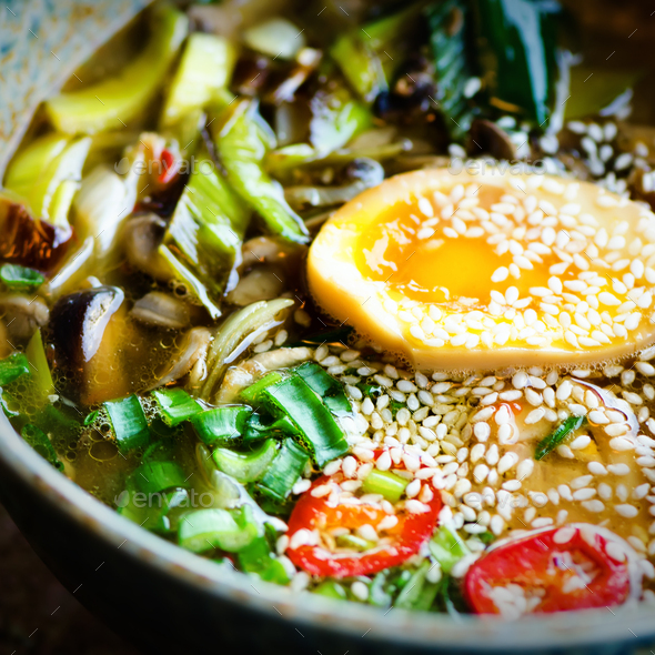 Ramen Soup in Bowl. Rich flavour chicken broth with Miso paste, grilled teriyaki chicken, leeks - Stock Photo - Images