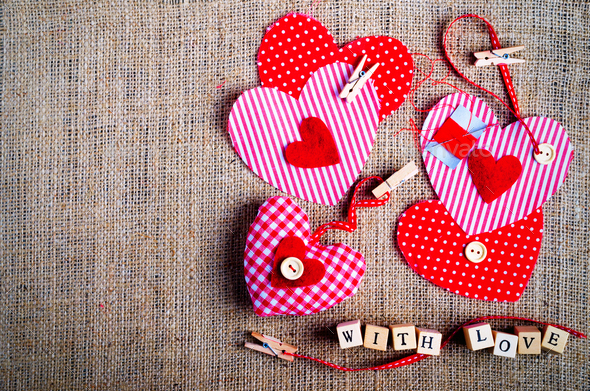 Sewing set: fabrics, threads, pins, buttons, tape and handmade hearts on burlap, sackcloth - Stock Photo - Images