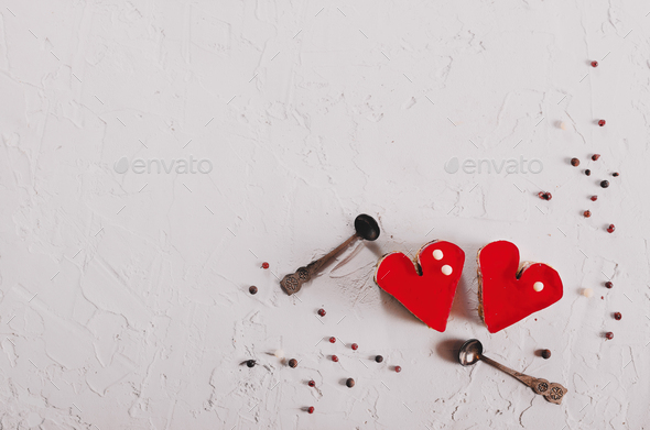 Two jelly heart-shaped cakes on white concrete background. Free space for your text. Toned effect - Stock Photo - Images