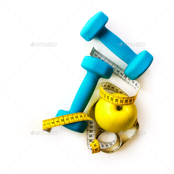 Fitness concept. Turquoise dumbbells, yellow measuring tape and fresh apple. Diet, sport, healthy - Stock Photo - Images