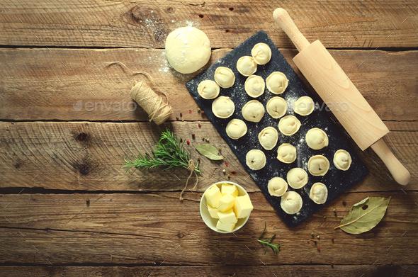 Ingredients for making pelmeni, ravioli, dumplings - dough, rosemary, rolling pin, canvas thread - Stock Photo - Images