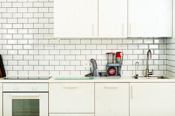 White minimalistic kitchen interior and design. Tile wall background. Household appliances - blender - Stock Photo - Images