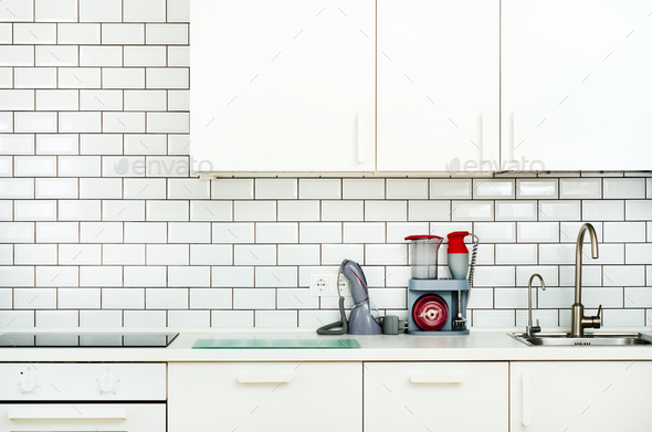 White interior design, modern and minimalist style kitchen with household appliances. Open space in - Stock Photo - Images