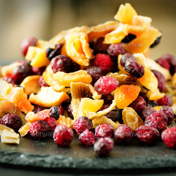 Mix of dried fruits on stone. Cranberry, rhubarb, apple, mango, cherry, peach, apricot. Handmade - Stock Photo - Images