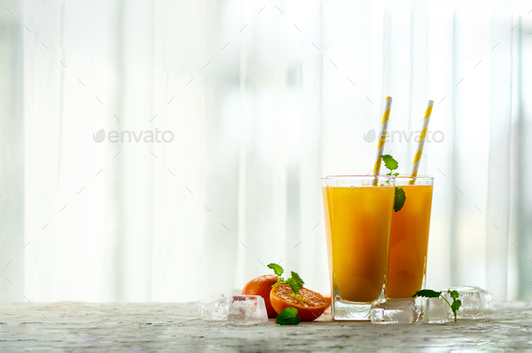 Fresh orange juice, mint and ice on white background, top view, copy space. Summer cocktail, drink - Stock Photo - Images