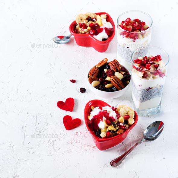Healthy breakfast - pomegranate, yogurt, granola parfait on white concrete background. Romantic time - Stock Photo - Images