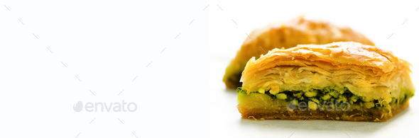 Middle eastern dessert baklava on white background. Free space for your text. Banner - Stock Photo - Images