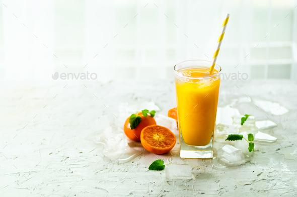 Orange juice with ice and tangerines on white background. Free space for your text. Copyspace. Cold - Stock Photo - Images
