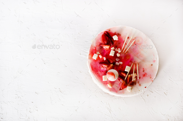 Delicious strawberry cheesecake, fresh berries, coconut, and sweet decor element on top, white - Stock Photo - Images