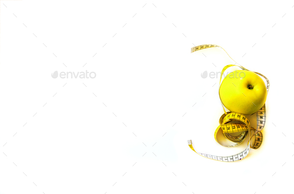 Measuring tape wrapped around fresh tasty yellow apple isolated on white background. Diet, weight - Stock Photo - Images