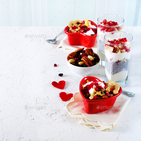 Romantic breakfast with chia, granola, yogurt and berries on old white concrete background. Health - Stock Photo - Images