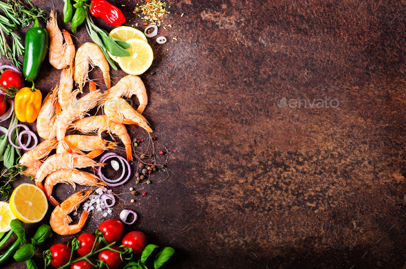 Fresh fish, shrimps with herbs, spices and vegetables on dark vintage background. Healthy food, diet - Stock Photo - Images