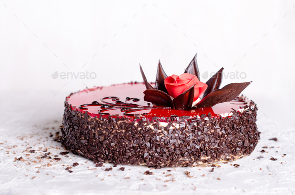 Red Cake with rose on white concrete background. Top view. Valentine's Day. Free space for your - Stock Photo - Images