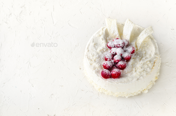 Delicious cheesecakes with cranberries, cherries, coconut flakes and white chocolate on light - Stock Photo - Images