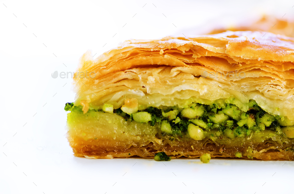 Baklava with pistachios, walnuts and honey on white background. Jewish, turkish, arabic traditional - Stock Photo - Images