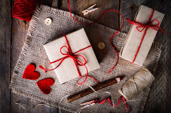 Vintage gift boxes with blank gift tag on old wooden background - Stock Photo - Images